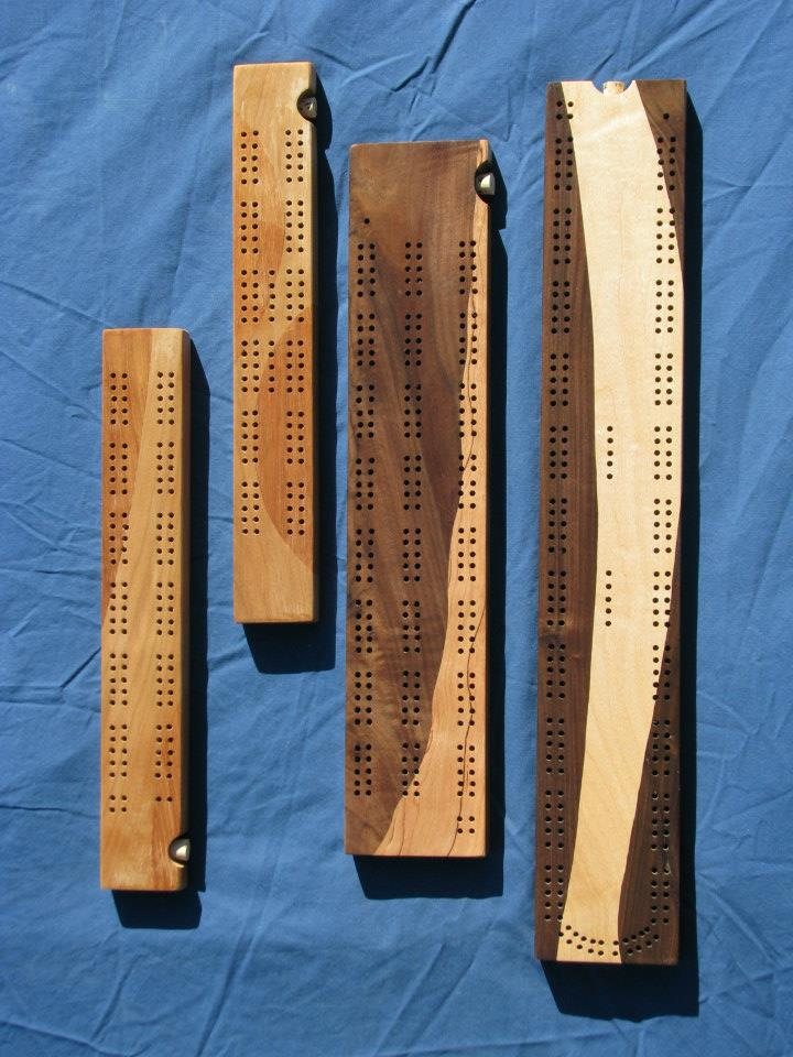 Small and large cribbage boards; Cherry, Maple and Walnut