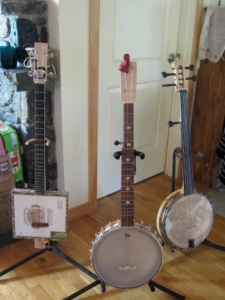 Cigar box and two open-backed banjos