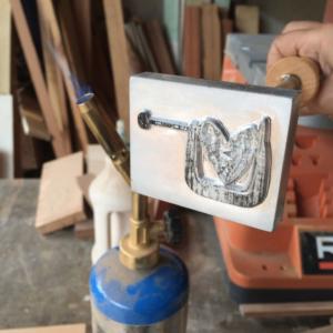 wood burning logo